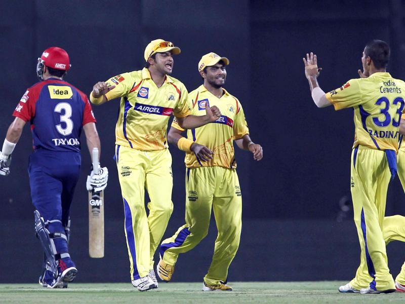 Chennai Super Kings fielder Suresh Raina celebrates with teammates after he takes the catch of Delhi Daredevils' Ross Taylor during the IPL Qualifier 2 match at MA Chidambaram stadium in Chennai. HT/Santosh Harhare