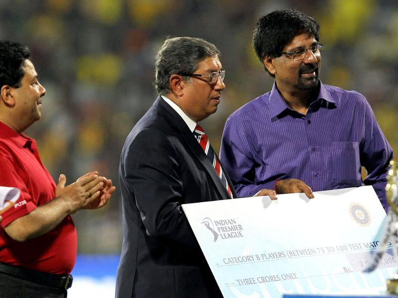 Krishnamachari Shrikanth receives a cheque from BCCI president N Srinivasan during the IPL T20 cricket 2nd Qualifier match between Chennai Super Kings and Delhi Daredevils at the MA Chidambaram Stadium in Chennai. PTI/R Senthil Kumar