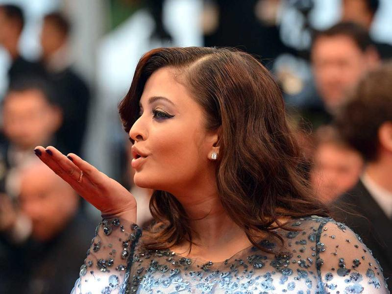 Ash blows a kiss to her fans at the Cannes film festival.
