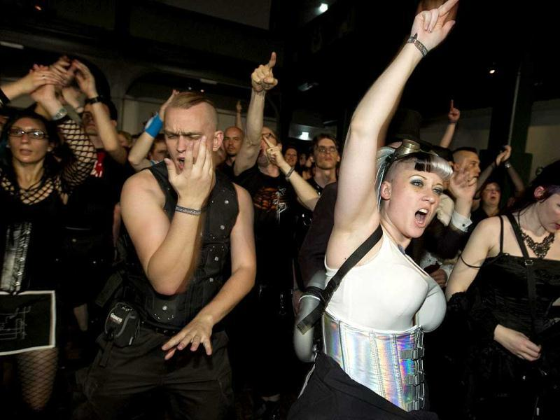 Revellers dance during a concert at the Wave and Goth festival in Leipzig. Reuters Photo/Thomas Peter