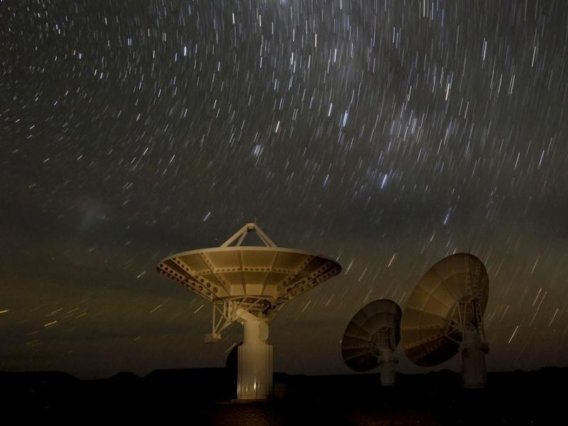 Star trails form over radio telescope dishes of the KAT-7 Array in a long exposure picture taken at the proposed South African site for the Square Kilometre Array (SKA) telescope near Carnavon in the country's remote Northern Cape province, in this picture. Reuters/Mike Hutchings