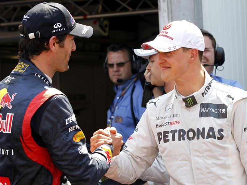 Mercedes Grand Prix driver Michael Schumacher of Germany, right, quickest time, shakes hand with Red Bull driver Mark Webber of Australia, second fastest time, after the qualifying session at the Monaco racetrack, in Monaco. AP/Luca Bruno