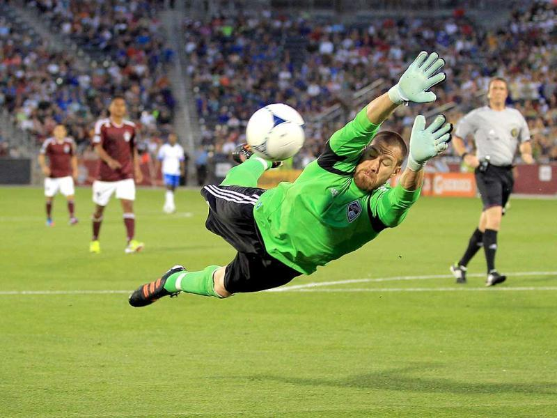 Goalkeeper Matt Pickens #18 of the Colorado Rapids dives to make a save against the Montreal Impact at Dick's Sporting Goods Park in Commerce City, Colorado. The Rapids defeated the Impact 3-2. AFP/Doug Pensinger
