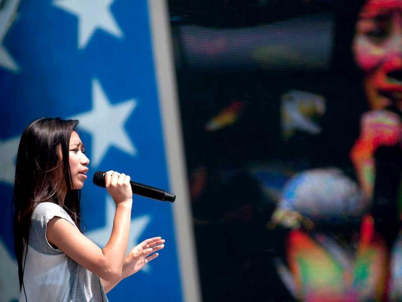 Jessica Sanchez performs during the 2012 PBS National Memorial Day concert rehearsal at the US Capital, West Law in Washington, DC. AFP/Kris Connor