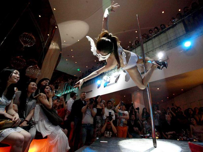 A contestant takes part in a pole dancing competitions in Beijing. AP/Ng Han Guan