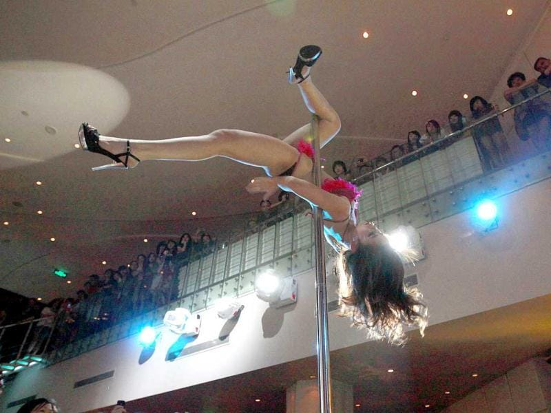 A contestant takes part in a pole dancing competition held in Beijing. AP Photo/Ng Han Guan
