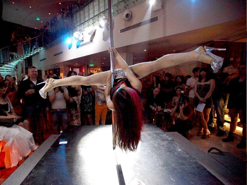 A contestant takes part in a pole dancing competition in Beijing. AP Photo/Ng Han Guan