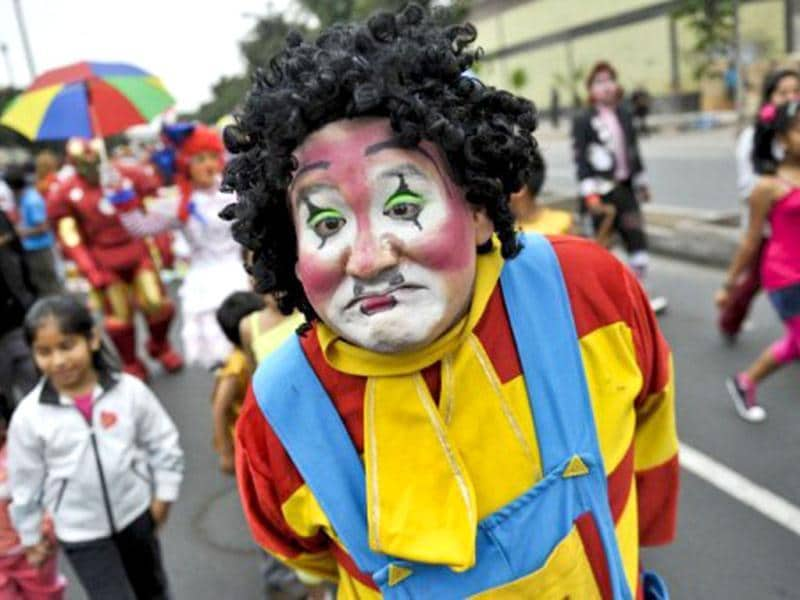 A clown joins hundreds of other clowns in a demonstration along the streets of Lima to demand the Peruvian Congress to create a