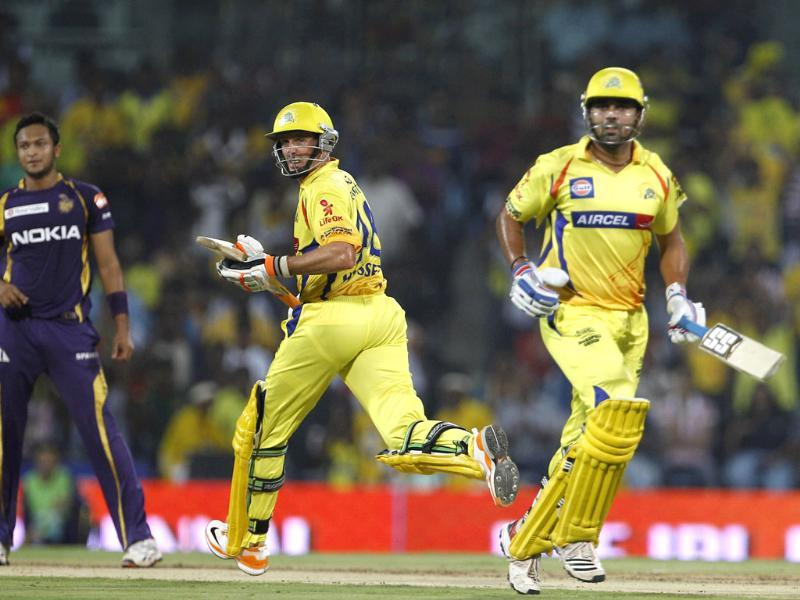 Chennai Super Kings' batsmen Michael Hussey and Murali Vijay run between the wickets as Kolkata Knight Riders bowler Shakib Al Hasan watches during their Indian Premier League (IPL) final cricket match in Chennai .(AP Photo/Aijaz Rahi)
