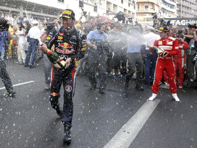 Red Bull driver Mark Webber of Australia celebrates with champagne after winning the Formula One Grand Prix, at the Monaco racetrack, in Monaco. (AP Photo/Luca Bruno)