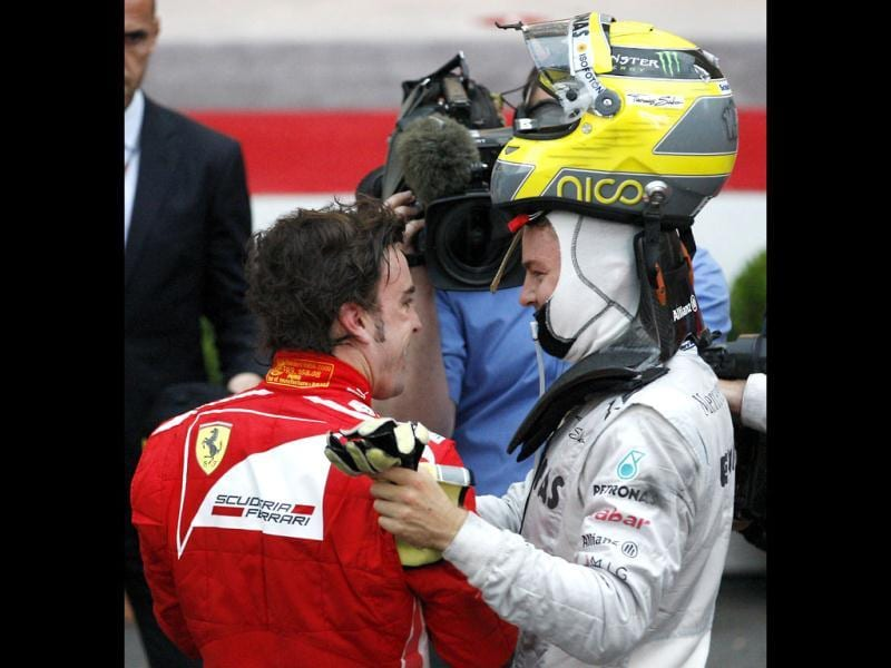 Second placed Mercedes Grand Prix driver Nico Rosberg, right, of Germany, smiles with third placed Ferrari driver Fernando Alonso, of Spain, after the Monaco Formula One Grand Prix at the Monaco racetrack, in Monaco. (AP Photo/Antonio Calanni)