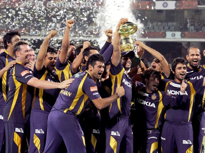 Kolkata Knight Riders players celebrate after winning the IPL Twenty20 cricket final match against Chennai Super Kings (CSK) at the MA Chidambaram Stadium in Chennai. AFP PHOTO/Dibyangshu SARKAR