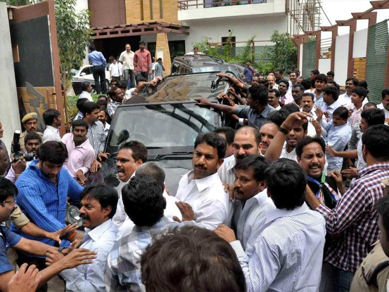 Supporters of YSR Congress party surround a car carrying chief YS Jagan Mohan Reddy at Central Bureau of Investigation (CBI) office in Hyderabad on Sunday in connection with an alleged disproportionate assets case. PTI Photo
