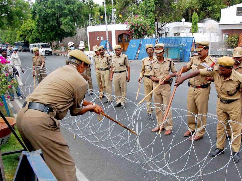 Policemen fixing barbed wire at a road near the guest house where YSR Congress President Jagan Mohan Reddy appeared before the CBI officials in Hyderabad for the third consecutive day on Sunday in connection with the alleged disproportionate assets case against him. PTI Photo