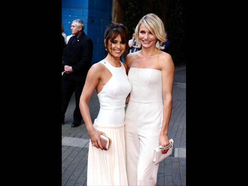 Cheryl's bra makes its presence rather apparent as she poses with Cameron Diaz.