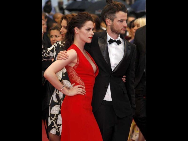Kristen (pictured here with British actor Tom Sturridge) was wearing a red Reem Acra dress.
