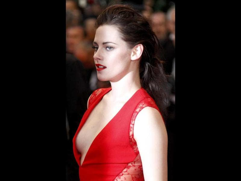 Kristen Stewart wore a striking red gown with a very plunging neckline at the premiere of Cosmopolis at Cannes. However, she almost suffered a wardrobe malfunction as she nearly showed off her entire breast.