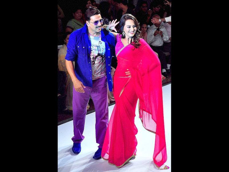 Akshay Kumar and Sonakshi Sinha pose on the ramp during the third day of Rajasthan Fashion Week 2012. (PTI Photo)