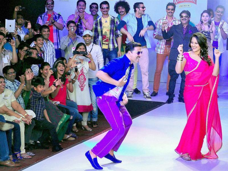 Akshay Kumar and Sonakshi Sinha break into dance while they walk the ramp during the third day of Rajasthan Fashion Week 2012 in Jaipur on May 26. (PTI Photo)