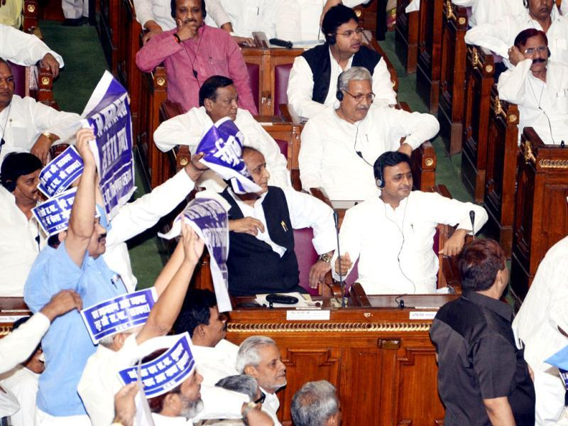 BSP legislators hold aloft placards against government policies around Uttar Pradesh chief minister Akhilesh Yadav and senior cabinet minister Azam Khan at the beginning of joint session of assembly in Lucknow.