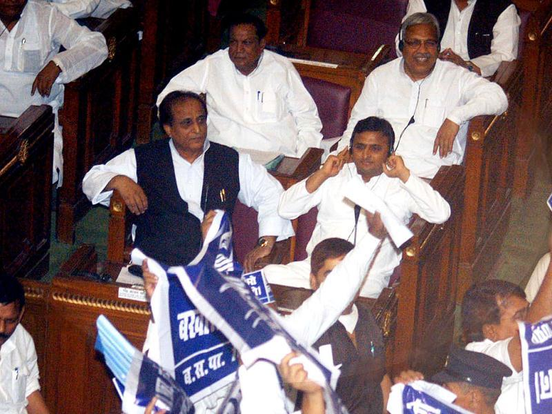 BSP legislators hold aloft placards against Uttar Pradesh chief minister Akhilesh Yadav and cabinet minister Azam Khan at the beginning of joint session of assembly in Lucknow.