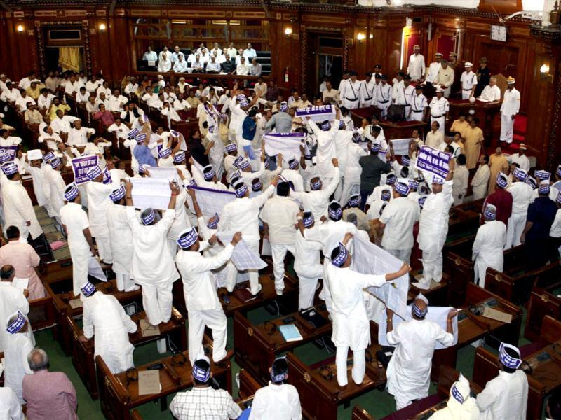 BSP members create a ruckus in Uttar Pradesh Vidhan Sabha during the governor's speech on the first day of budget session in Lucknow. PTI/Nand Kumar