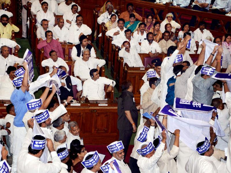 BSP members create a ruckus in the well of Uttar Pradesh Vidhan Sabha during the governor's speech on the first day of budget session in Lucknow. PTI/Nand Kumar