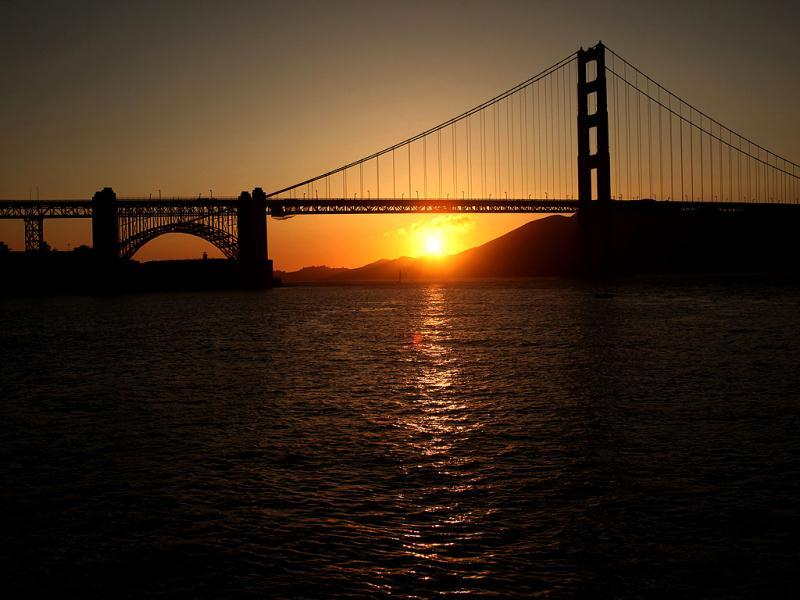 The sun sets near the Golden Gate Bridge before a fireworks show during the 75th anniversary celebration of the iconic span in San Francisco, California. Reuters/Robert Galbrait