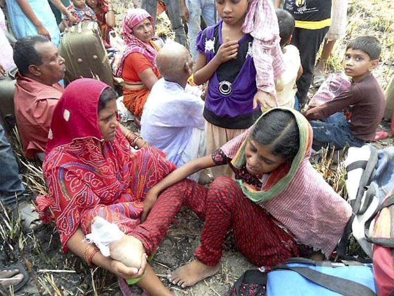 An injured girl and other passengers near the site of accident after Doon Express, on its way from Howrah to Dehradun, derailed near Koridia village about 35 km from Jaunpur in Uttar Pradesh. PTI Photo