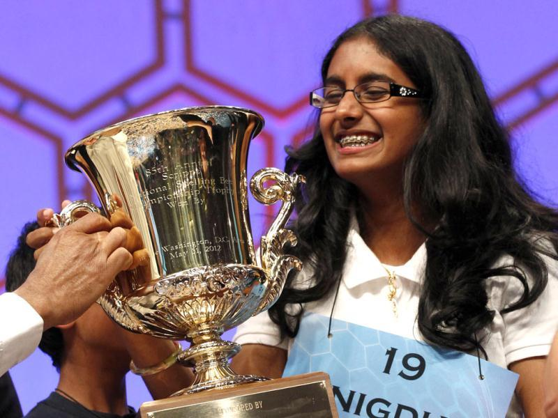 Snigdha Nandipati, 14, of San Diego, California, holds her trophy after winning the Scripps National Spelling Bee at National Harbor in Maryland. Reuters/Kevin Lamarque