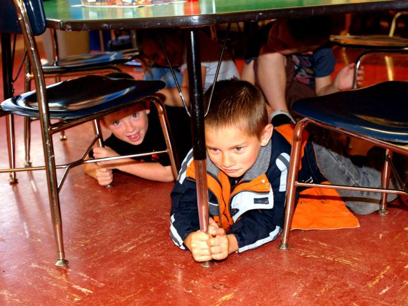 Kindergarteners duck and cover during an earthquake and tsunami drill at Blossom Gulch Elementary School in Coos Bay, Ore. AP/Jeff Barnard