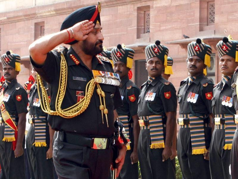 Newly appointed army chief General Bikram Singh salutes as he inspects the guard of honour after taking over the charge in New Delhi. Reuters/B Mathur