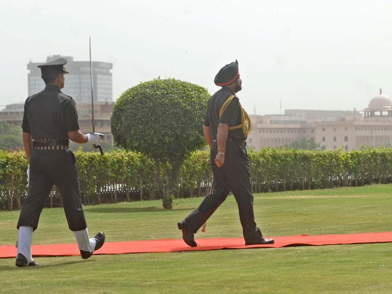 New chief of the army staff General Bikram Singh on his way to inspect a guard of honour prior to assuming office in New Delhi.