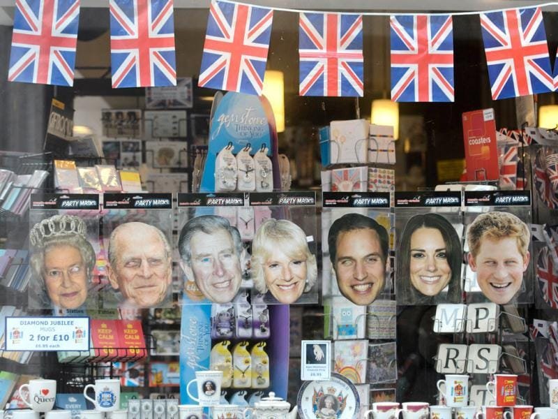 Souvenirs including paper masks of (L-R) Britain's Queen Elizabeth II, Prince Philip, Duke of Edinburgh, Prince Charles, Prince of Wales, Camilla, Duchess of Cornwall, Prince William, Catherine, Duchess of Cambridge and Prince Harry are displayed at a store in central London ahead of the long weekend of celebrations to mark the Queen's diamond jubilee. AFP/Leon Neal