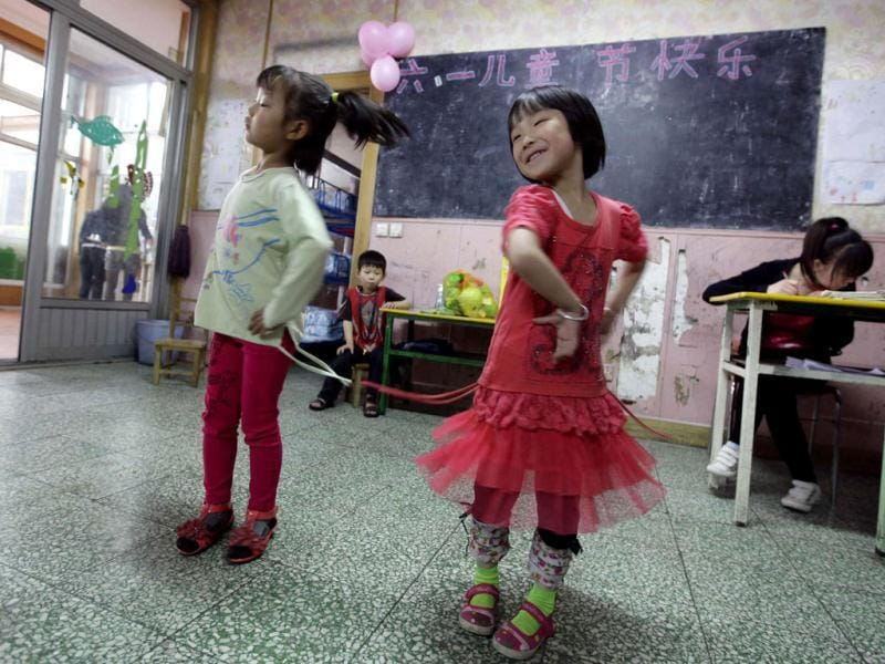 Girls perform to celebrate International Children's Day at a kindergarten for children of migrant workers, in Beijing. Reuters/Jason Lee