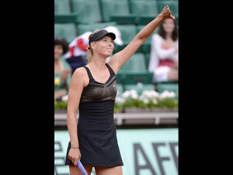Russia's Maria Sharapova reacts after winning over Japan's Ayumi Morita during their Women's Singles 2nd Round tennis match of the French Open tennis tournament at the Roland Garros stadium in Paris. AFP/Pascal Guyot
