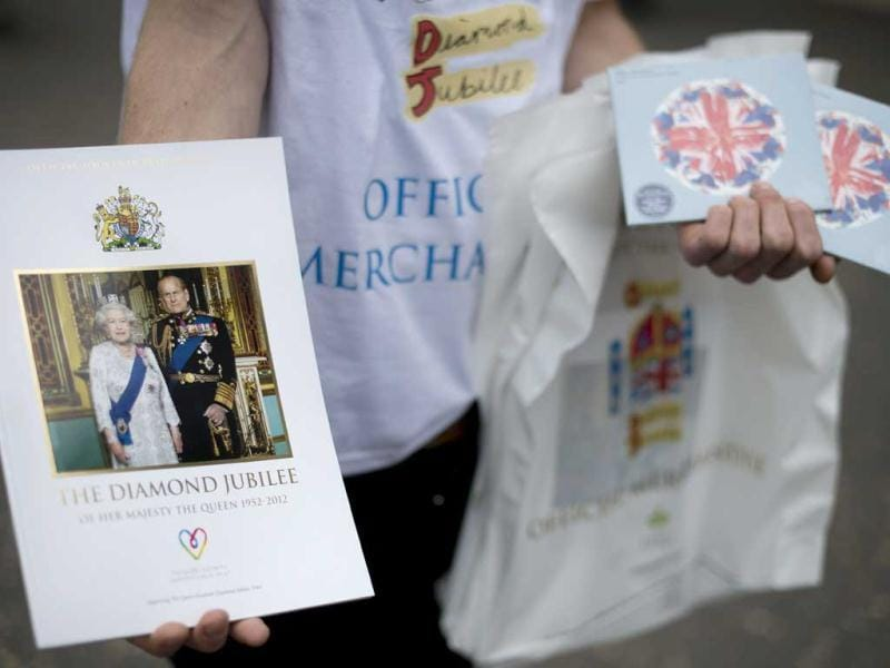 A vendor poses with Diamond Jubilee merchandise during Ladies Day, the first day of the Epsom Derby horse racing event, at Epsom in Surrey. AFP/Ben Stansall