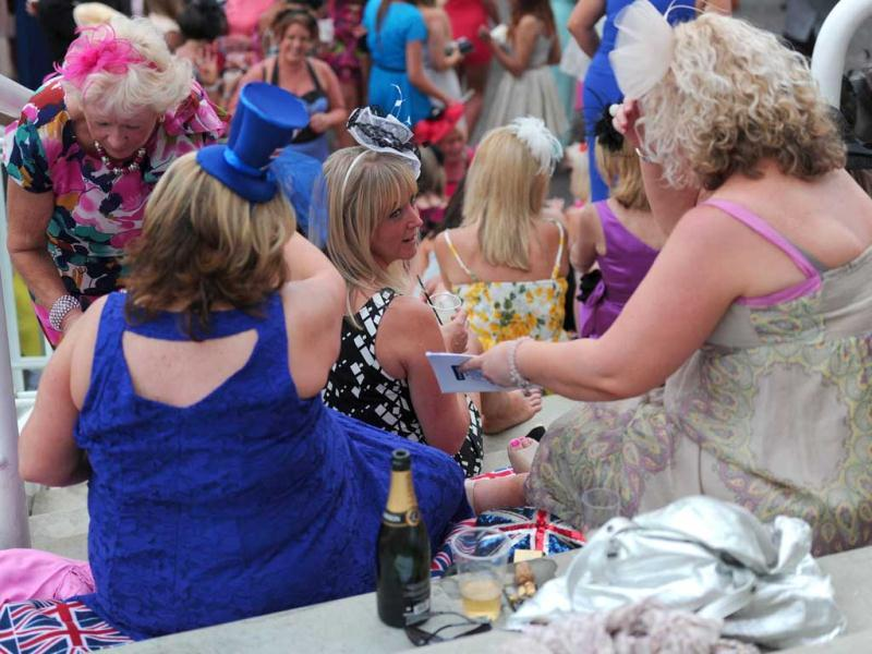Racegoers attend Ladies' Day, the first day of the Epsom Derby horse racing event, at Epsom in Surrey. AFP/Carl Court