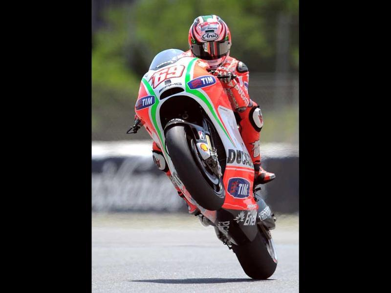 Ducati Team's US Nicky Hayden of makes a wheelie at the Catalunya racetrack in Montmelo, near Barcelona, during the MotoGP second training session the Catalunya Moto GP. AFP/Lluis Gene