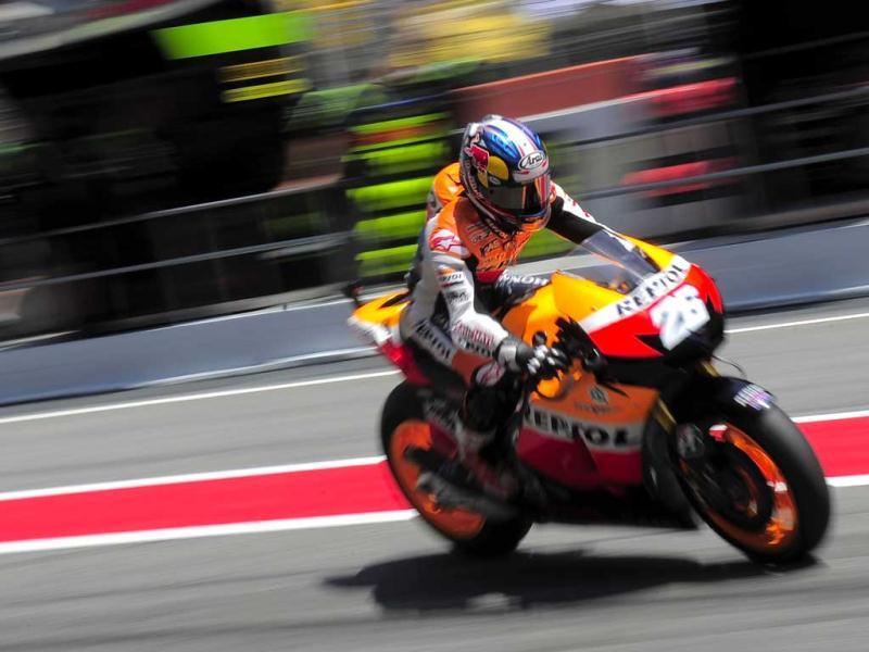 Repsol Honda Team's Spanish Dani Pedrosa leaves the pits of the Catalunya racetrack in Montmelo, near Barcelona, during the MotoGP second training session of the Catalunya Moto GP. AFP/Josep Lago