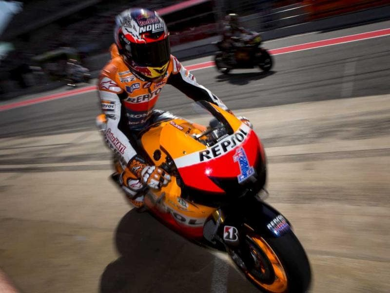 MotoGP Honda rider Casey Stoner of Australia rides his motorcycle outside his pit box during free practice sessions ahead of Sunday's Spain Motorcycling MotoGP at the Montmelo racetrack near Barcelona, Spain. AP/Emilio Morenatti