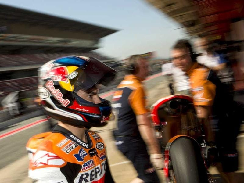 MotoGP Honda rider Dani Pedrosa of Spain walks outside his pit box during free practice sessions ahead of Sunday's Spain Motorcycling MotoGP at the Montmelo racetrack near Barcelona, Spain. AP/Emilio Morenatti