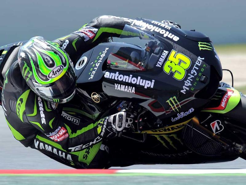 Monster Yamaha Tech 3 British Cal Crutchlow takes a curve at the Catalunya racetrack in Montmelo, near Barcelona, during the MotoGP second training session the Catalunya Moto GP. AFP/Lluis Gene