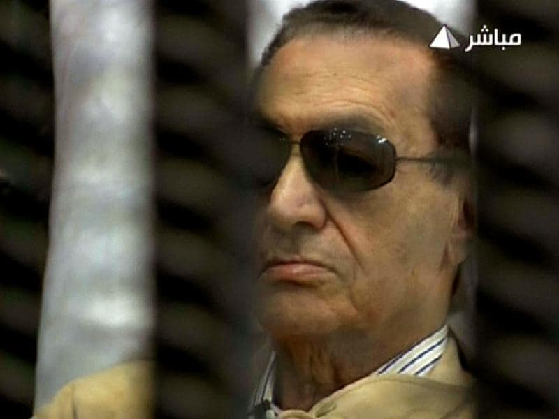 An image grab taken from Egyptian state TV shows ousted Egyptian president Hosni Mubarak sitting inside a cage in a courtroom during his verdict hearing in Cairo. AFP photo