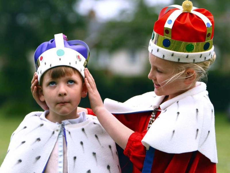 Adam, six and Lucy Fergusson, seven, dressed as the Queen Elizabeth II and Prince Philip during a parade through Chichester, England as part of the celebrations to mark Queen Elizabeth II's Diamond Jubilee. AP/Chris Ison