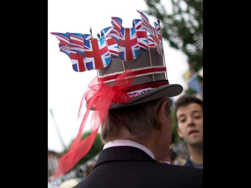 A man wears a hat on which he sticked British flags during a street party orgnised by residents of Battersea in south London as Britain celebrates Queen Elizabeth II's Diamond Jubilee. AFP/Andrew Cowie