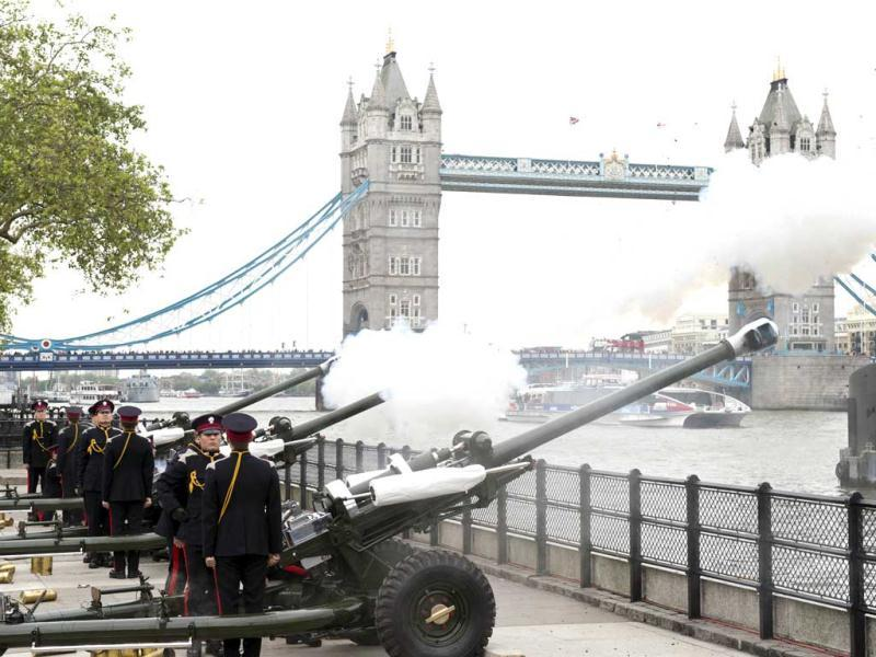 Soldiers of the Honorable Artillery Company fire blank rounds during a 62 gun salute at the Tower of London to mark the start of diamond jubilee weekend celebrations for Britain's Queen Elizabeth II. AFP/Miguel Medina