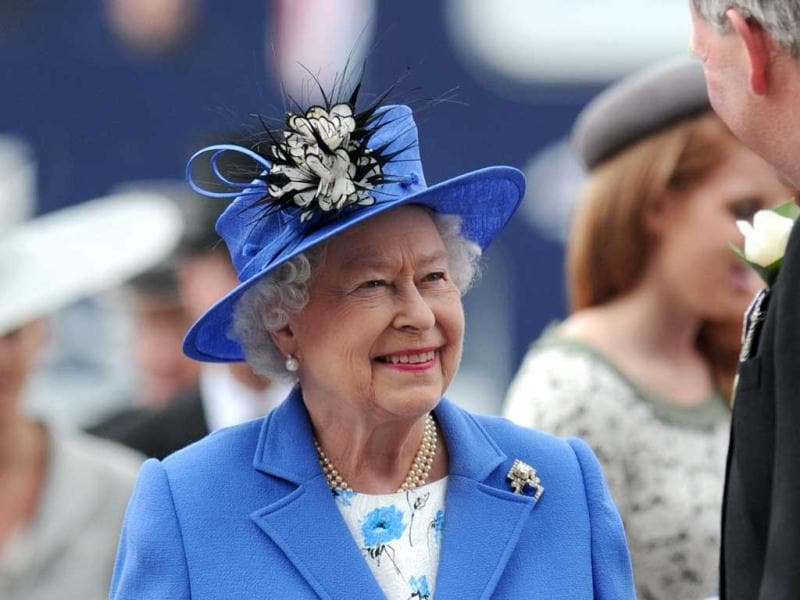 Britain's Queen Elizabeth II arrives on Derby Day, the second day of the Epsom Derby horse racing festival, at Epsom in Surrey, the first official day of Britain's Queen Elizabeth II's Diamond Jubilee celebrations. AFP/Carl Court