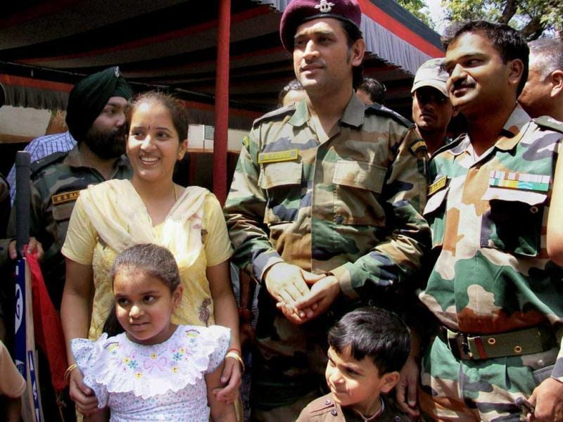 Lieutenant Colonel MS Dhoni, poses for a photo with a soldier and his family during an interaction with soldiers on the Line of Control (LoC) on Jammu and Kashmir's border with Pakistan, near Jammu on Saturday. (PTI Photo)