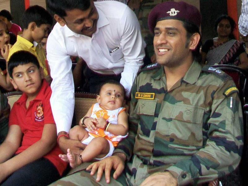 Lieutenant Colonel MS Dhoni, interacts with a soldier's family on the Line of Control (LoC) on Jammu and Kashmir's border with Pakistan, near Jammu on Saturday. (PTI Photo)